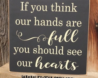 If you think our hands are full, you should see our hearts-Family wood home decor Sign with vinyl lettering, new parent, child