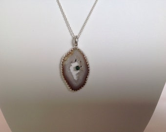 Genuine geode slice, handmade pendant with a green tourmaline. Set in solid sterling silver.