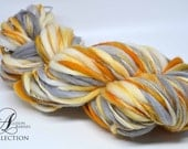 3 skeins of handspun thick and thin yarn in Gold, Grey and White