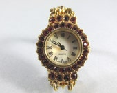 Vintage Ruby Red Rhinestone Quartz Goldtone Watch w/ Mother of Pearl Face