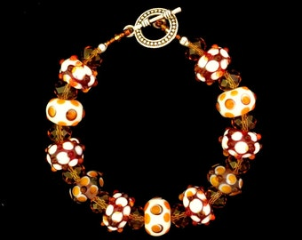 Handmade Bracelet Lampwork Amber and Ivory colored Glass Bead Bracelet Toggle Clasp