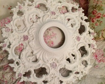 A vintage  flowered baroque white ceiling medallion