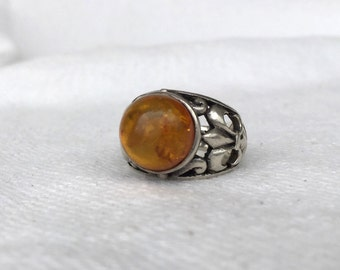 Sterling and amber ring huge domed amber estate ring set in fleur de lis sterling silver band large size 6.5 amber inclusions