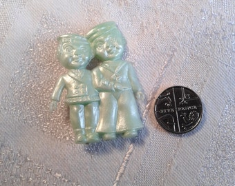 Vintage Plastic, Celluloid Brooch of a Sailor and His Girl.