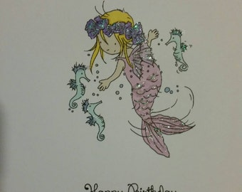 Glittered mermaid birthday card handcoloured and personalised with seahorses