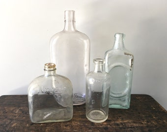 Lot of 4 Antique Bottles - Lavoris, Nujol, Dr Kilmer's Swamp Root Kidney Liver & Bladder Cure and Old Glass Flask Bottle
