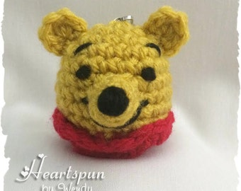 Winnie the Pooh inspired EOS Lip Balm Holder with clip to attach to a key chain or bag.  Hand crocheted, fits eos or similar lip balm.