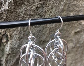Silver orbital earrings
