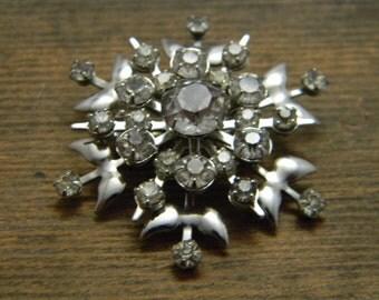 Vintage Rhinestone Snowflake brooch in silver tone