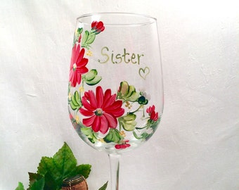 Personalizable hand painted floral wine glass for sisters or friends and family members and bridesmaidd.