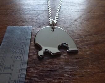 A Miniature Puzzle Piece Silver Pendant Necklace