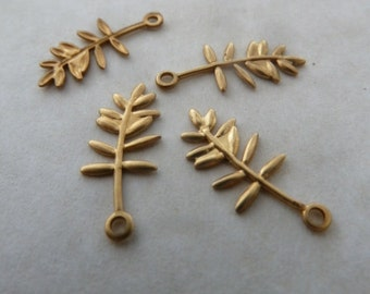 4 tiny usa made pressed brass leaf drops. size is 16.5mm long by 7 mm wide