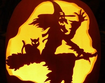 "Witch and Cat on broom hand-carved on a 13"" foam pumpkin"