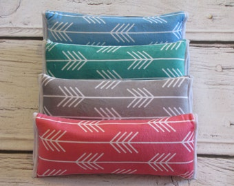 Arrow Seatbelt Pillows in Pink, Grey, Green, and Blue. Perfect for traveling