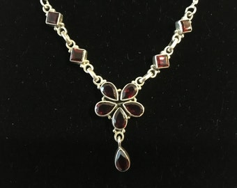 Silver and garnet necklace.