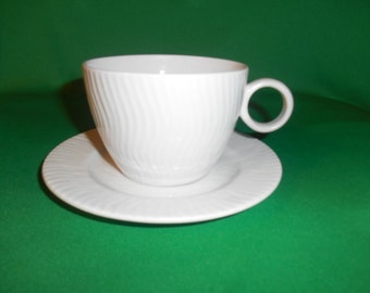 "One (1), 2 3/4"" Flat Cup & Saucer, from Gibsons Designs, in the Seacrest Pattern."
