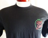 vintage 80's 90's Hot Shot Bar solid black graphic t-shirt red green palm chest logo print souvenir loose boxy fit made in usa Medium  Large