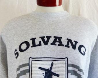 vintage 90's Solvang California Danish Village heather grey fleece graphic sweatshirt navy blue black white crest puffy print logo crew XL