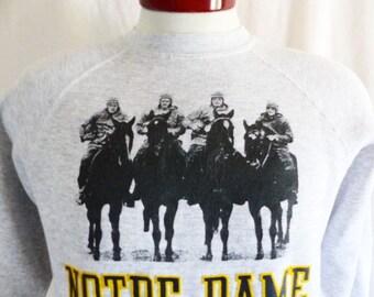 Go UND Fightin' Irish vintage 80's University of Notre Dame football Tradition graphic heather grey fleece sweatshirt raglan puffy print  Md