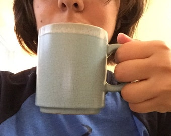 Two stackable blue mugs