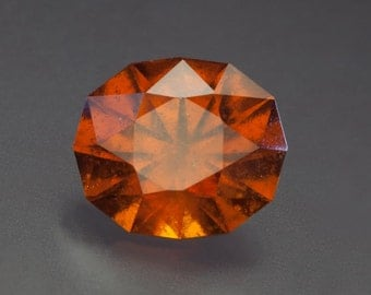 6.80ct- 10.21 X 12.06mm Vibrant Burnt Orange Faceted Hessonite Garnet Oval Loose Gemstone from Mozambique.