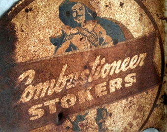 Antique service sign, metal advertising sign , Combustioneer Stocker sign ,  sales and service sign , rusty wall sign