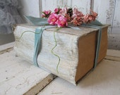 Large thick book stack table decor shabby cottage chic painted pale blue books embellished shabby cottage chic pink roses anita spero design