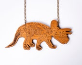 Triceratops Skeleton Dinosaur Necklace. Laser Cut Acrylic/Wood Dinosaur Necklace. Dinosaur Chain. Statement Necklace. Dinosaur Pendant.
