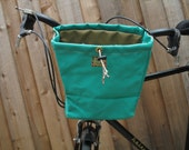 Large green handlebar bag