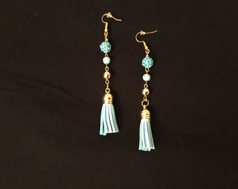 Beautiful blue and gold dangling earring with a tassle