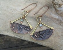 electroformed capsella leaves imprint earrings with green glass bead