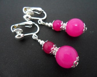 A pair of pretty bright pink  jade   dangly clip on earrings.