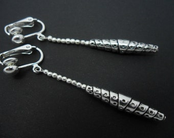 A pair of hand made tibetan silver slim dangly clip on earrings.