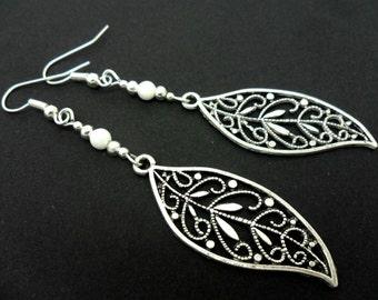 A pair of pretty tibetan silver & white jade bead  leaf themed long dangly earrings.