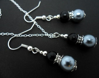 A hand made black and grey  glass pearl  necklace and earring set.