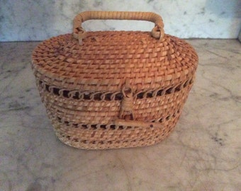 Child's woven rattan purse, 1950s-1960s