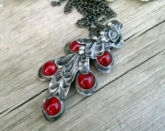 metal  pendant with carnelian