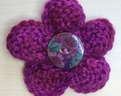 Knitted corsage (brooch) flower pin with ceramic button