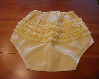 Ruffled panties size x-large pretty yellow with yellow gingham ruffles.  Appear to have never been worn.
