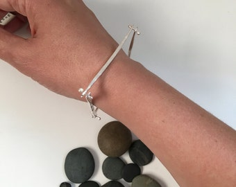 Hand forged sterling silver bangle