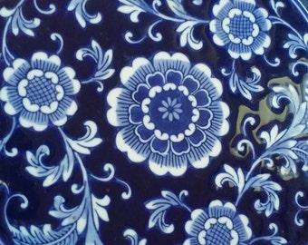 Vintage blue and white Asian ceramic trivet