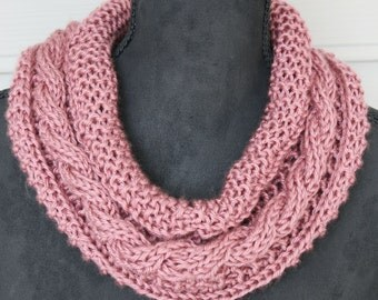 Dusty Rose makes this hand knitted cowl scarf a great accessory summer and winter.