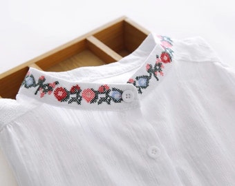 Woman flowers cross-stitch white blouse shirt