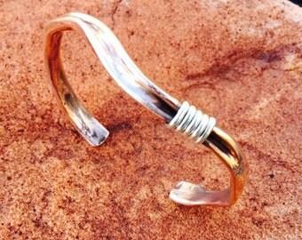 brass bracelet brac.with silver wire accent