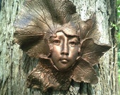 Art for your garden wall, fence and gate, handcrafted sculpture of a female face surrounded by leaves.  Autumn III by Gable Gargoyles