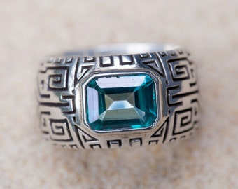 Sterling Silver tribal inscribed ring with Blue Topaz