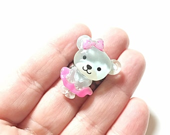 Bear in a pink dress ring