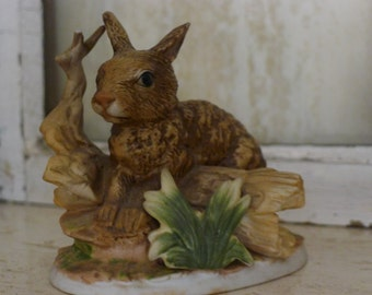 Porcelain brown rabbit figure with tree