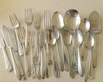 Collection of 23 vintage silverplate forks, spoons, butter knives and serving pieces