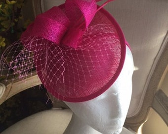 Hot pink/fushia fascinators/hatinators with loops, feathers and netting! One only!